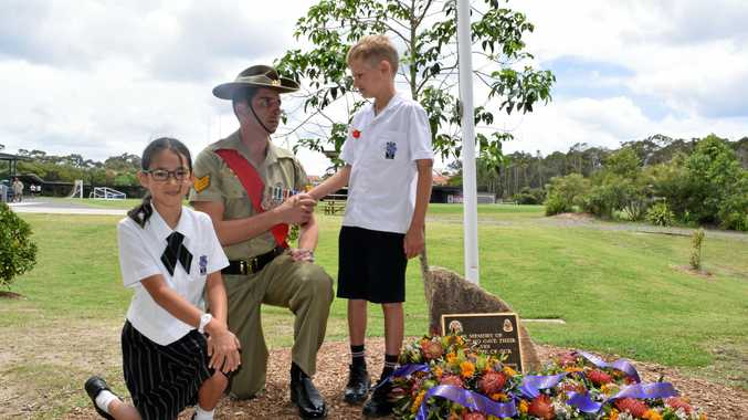 St Andrew's Anglican College Year 3 students Kate and Hugo with returned serviceman Sergeant Nicholas Korfias.