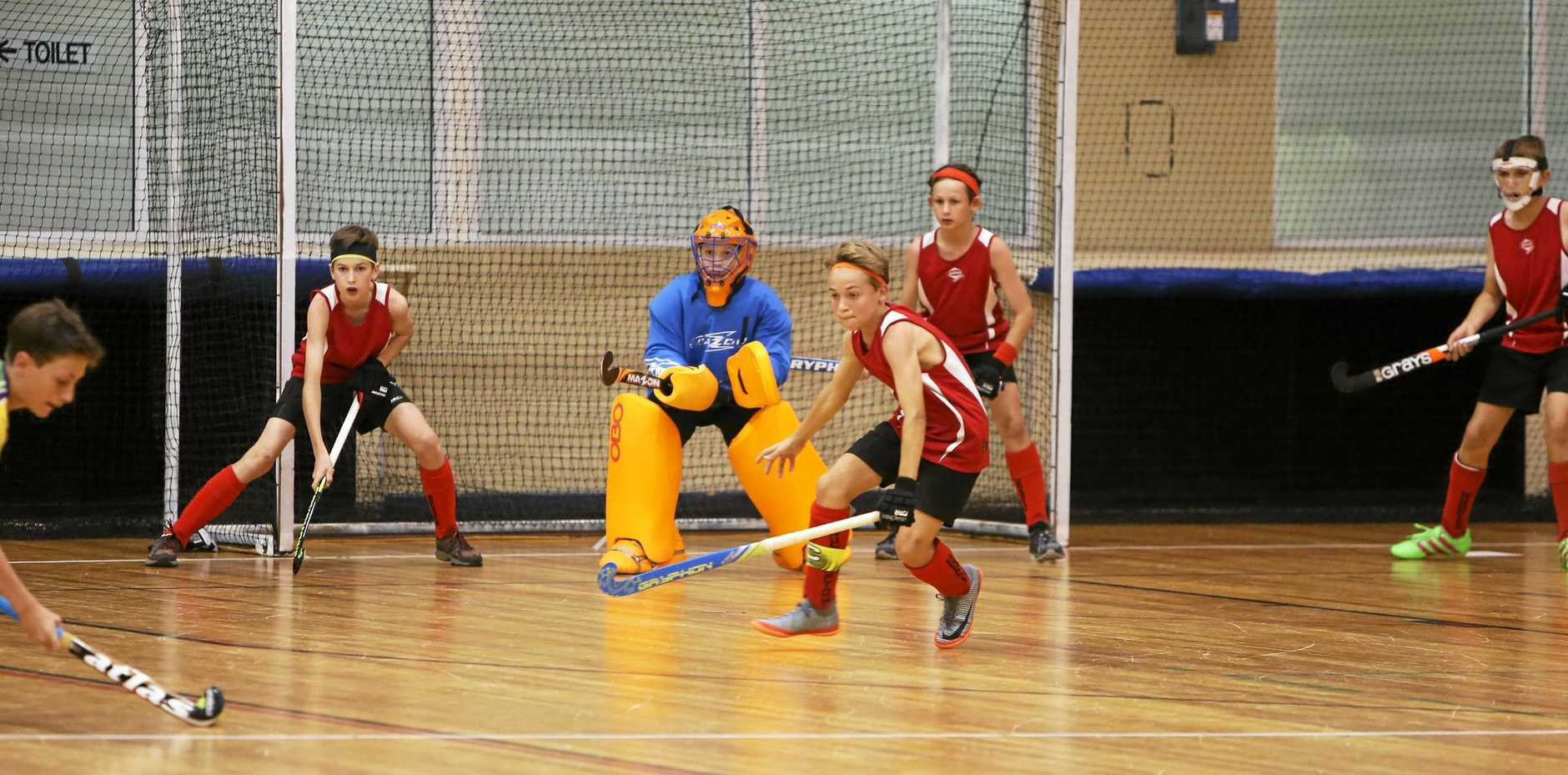 Action from the Rockhampton Red versus Brisbane Blue boys game.