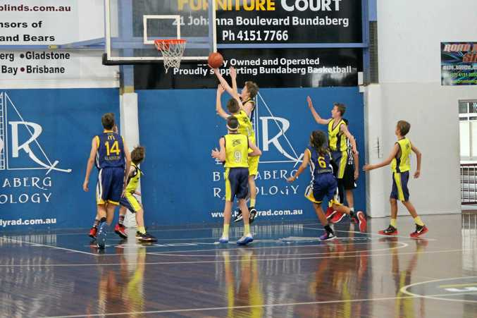 ON THE UP: Ben Knight drives hard to the rim against Hervey Bay in the CDC on the weekend. Ben's team finished undefeated.