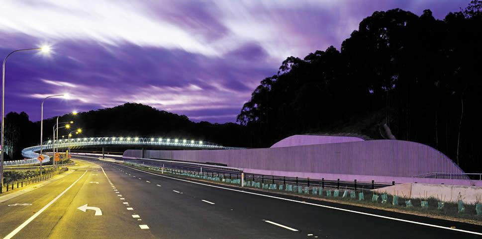 A man has been charged over a car crash in a roadwork zone on the Pacific Highway.