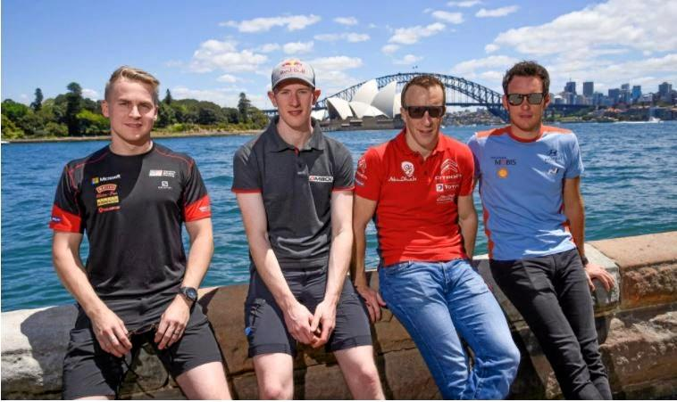 Relaxing beside Sydney Harbour after a game of beach cricket, World Rally Championship stars (from left) Espaekka Lappi, Elfyn Evans, Kris Meeke and Thierry Neuville.
