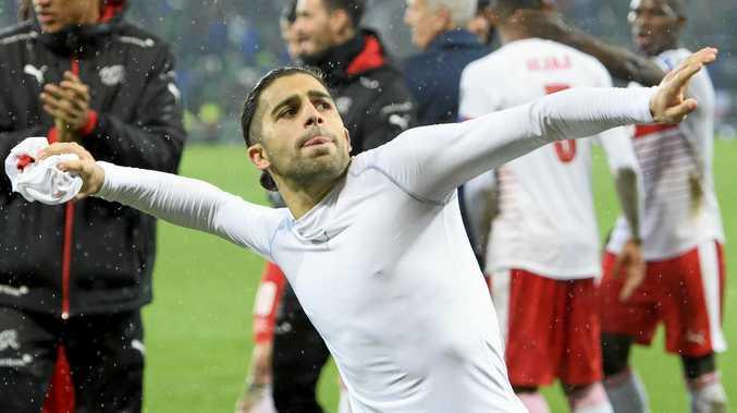 Switzerland defender Ricardo Rodriguez celebrates the victory over Northern Ireland.