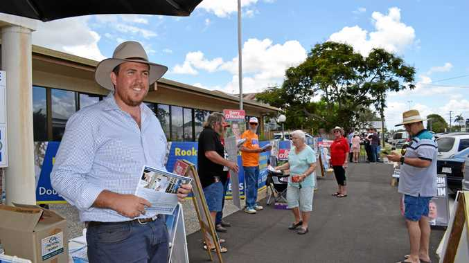 LNP candidate Douglas Rodgers meets with pre-polling voters at Campbell St.