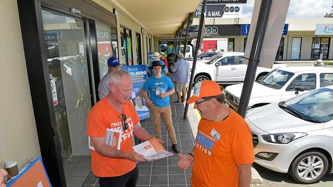 A SLOW start at the Buderim pre-poll centre on Wises Road. Steve Dickson (One Nation) pictured with a campaign worker while the LNP's Brent Mickelberg looks on.