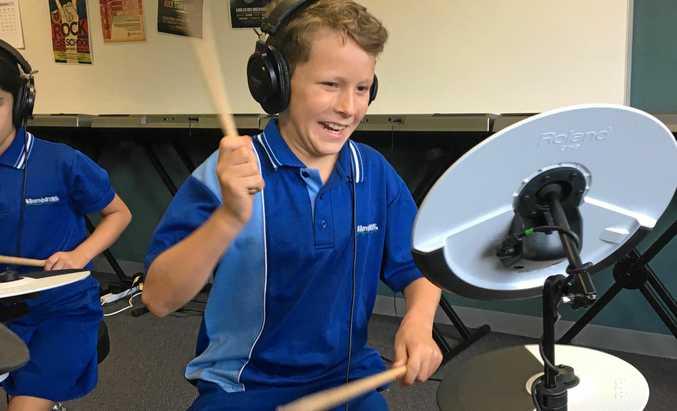 ROCK OUT: Bilambil  Public School student Jaspar  Damon hammers the drums as part of the Music Mates program.