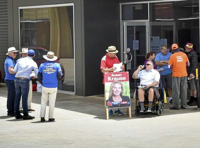 EARLY BALLOT: Supporters of the LNP, ALP and One Nation hand out how to vote cards at the Anzac Avenue pre-polling station.