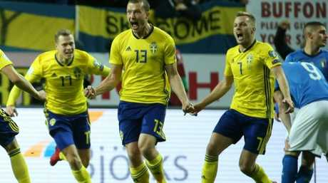 Sweden's midfielder Jakob Johansson celebrates his goal against Italy.