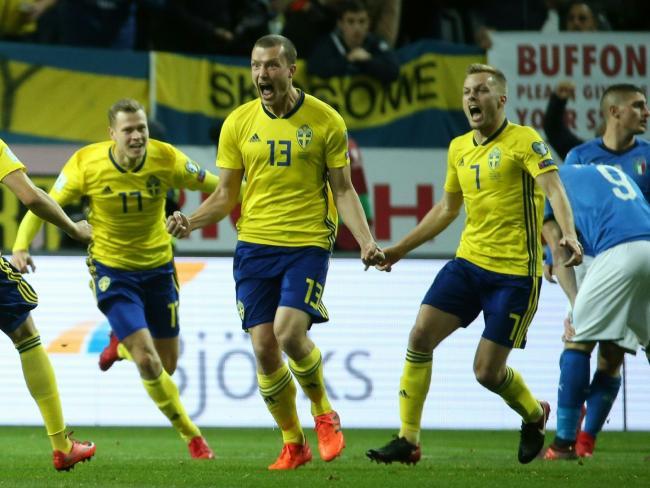 Sweden's midfielder Jakob Johansson celebrates his goal against Italy.