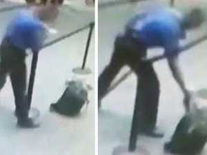 Moment airport worker grabs exploding bag