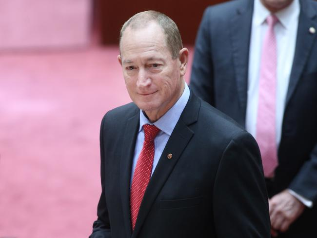 One Nation new Senator Fraser Anning defects after he was escorted into he chamber by Senators Cory Benardi and David Leyonhjelm. Picture Gary Ramage