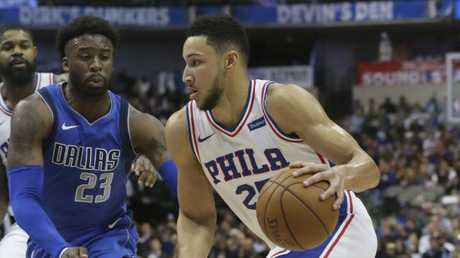 Philadelphia 76ers guard Ben Simmons drives against Dallas Mavericks guard Wesley Matthews.