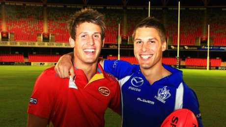 Gold Coast Suns player David Swallow (left) with brother Andrew Swallow at Metricon Stadium in 2011.