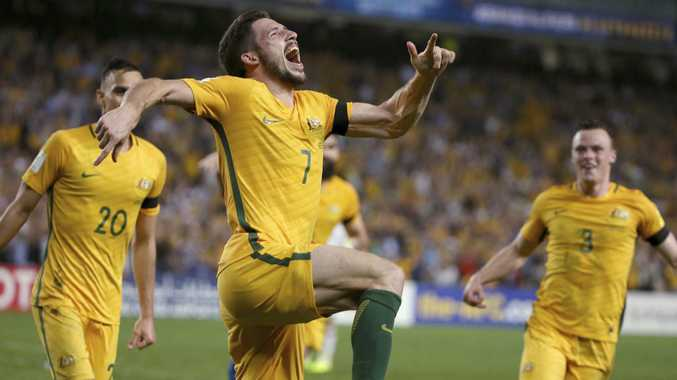Australia's Mathew Leckie, center, celebrates scoring against the United Arab Emirates during their world Cup qualifying soccer match in Sydney, Tuesday, March 28, 2017. (AP Photo/Rick Rycroft)