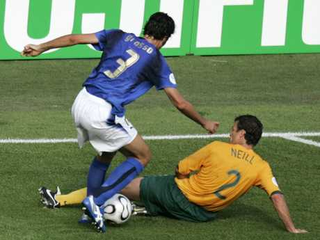 ** RECROP OF WCKAI 164 ** Australia's Lucas Neill, bottom, tackles Italy's Fabio Grosso in the penalty box during the last minutes of the Australia vs Italy Round of 16 World Cup soccer match at Fritz Walter Stadium in Kaiserslautern, Germany, Monday, June 26, 2006. Italy was awarded a penalty and won the match 1-0.(AP Photo/Emilio Morenatti) ** MOBILE/PDA USAGE OUT **