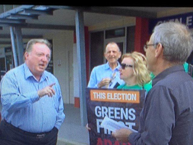 SHOWDOWN: Glen Elmes confronts Greens Noosa candidate Phillip Jenkins and party members outside his Noosa office.