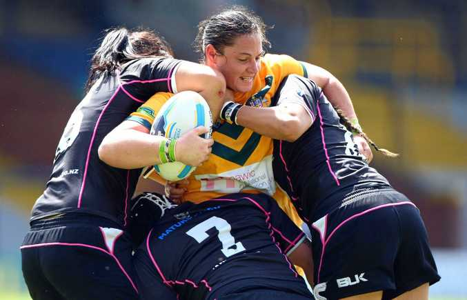 CUP APPEARANCE: Prop Stephanie Hancock takes on the New Zealand defence during one of her games for the Jillaroos. She is playing in her fourth World Cup this year.