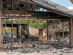 Devastated tennis club members sift through ashes after fire
