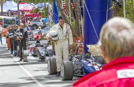 Drivers and marshals at the Noosa Hill Climb pay tribute as part of Remembrance Day.