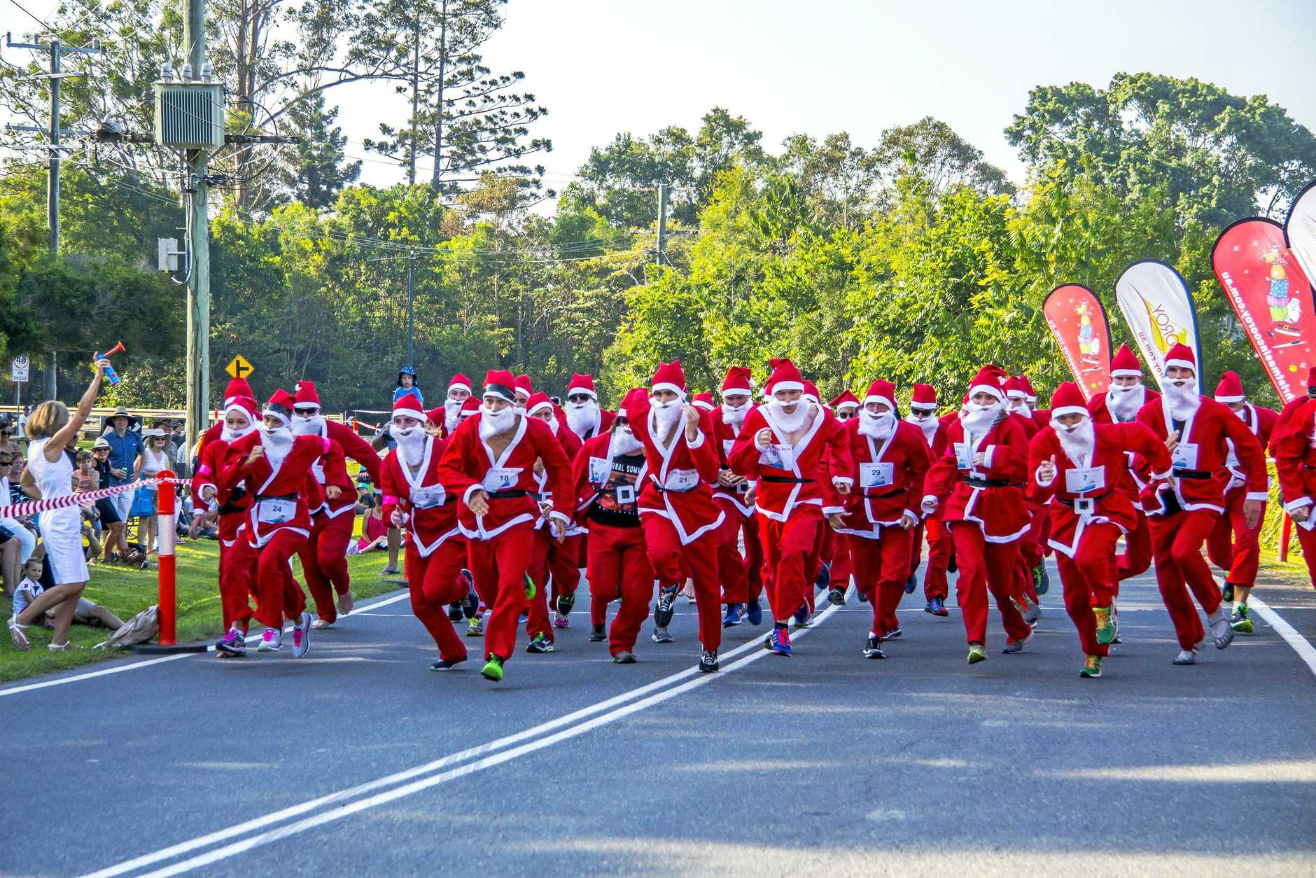 SPEED SANTAS: They're off and racing in the 2016 Santa race at Christmas in Cooroy.
