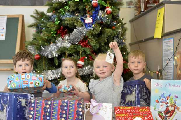 Eastwood Early Education students and staff support The Chronicle's Adopt-A-Family Appeal (from left) Tom Makkai, Belle Lawry, Ellie Radke and Archer Ehrlich.