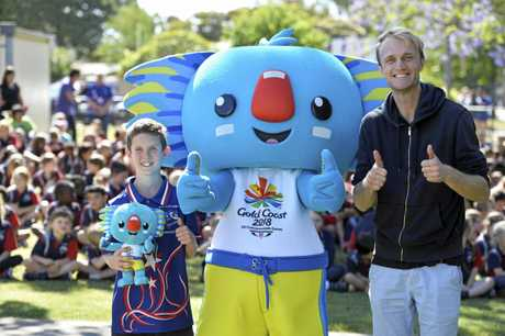 The Queens's Baton Relay baton bearers Harristown State School captain Sean Lindsay-Holley and chaplain Joshua Willis with Gold Coast Commonwealth Games mascot Borobi.