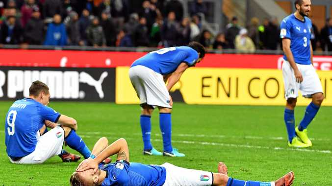 DOWN AND OUT: Italian players dejected after the FIFA World Cup 2018 qualification playoff, second leg against Sweden at the Giuseppe Meazza stadium in Milan, Italy. Sweden won 1-0 on aggregate.