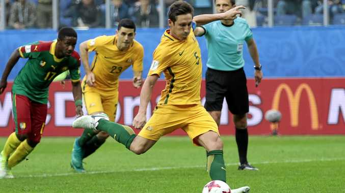 ADDED STRENGTH: Australia's Mark Milligan returns to the side after suspension and will likely sit alongside captain Mile Jedinak in the defencive midfield position.