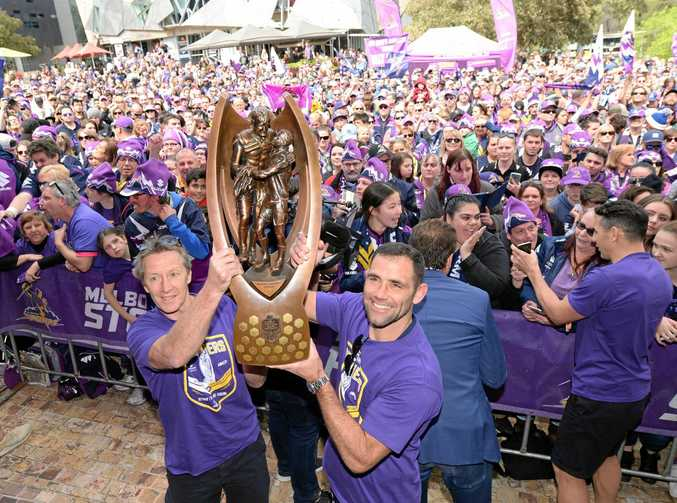 Storm coach Craig Bellamy (left) and captain Cameron Smith show off the NRL premiership trophy. The Storm will play Leeds Rhinos in Melbourne in the World Club Challenge