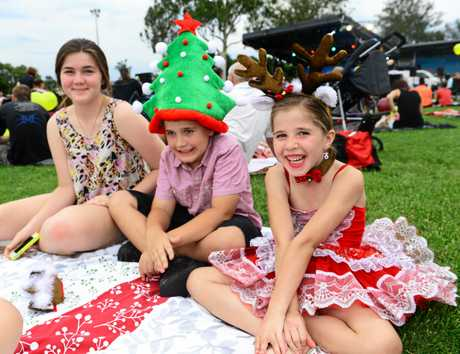 Brassall Christmas in the Park. Giordan Brett, 15, Connor Guy, 8, and Chelsea Guy, 6, all of Brassall. Photo: David Nielsen / The Queensland Times