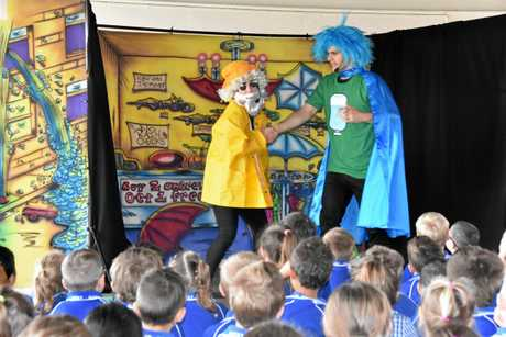 FUNNY: Performers Chelsea Zeller and Nick James from The National Theatre for Children teach children about water conservation at Gladstone West State School.