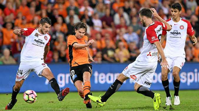 Roar player Brett Holman (in orange) says Brisbane can still make the A-League finals