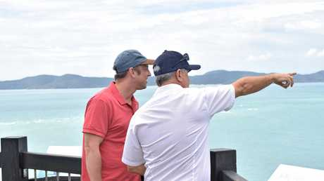 Environment Minister Steven Miles and Tourism Whitsundays chairman Al Grundy at the Whitehaven Beach lookout today.