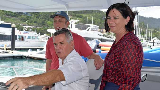 Environment Minister Steven Miles, Tourism Whitsundays chairman Al Grundy and Labor candidate for Whitsunday Bronwyn Taha on board the Bullet at Abell Point Marina this morning.