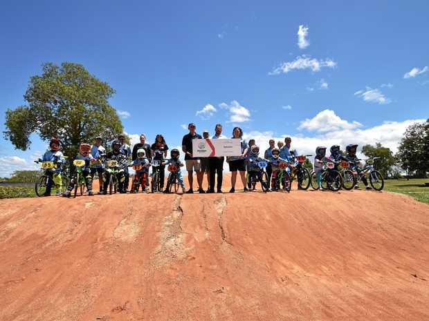 HELPING OUT: Casino BMX Club receives $20,000 from David Faiers, of Quayside Holden. Also pictured on the club's damaged track is Richmond Valley mayor Robert Mustow.