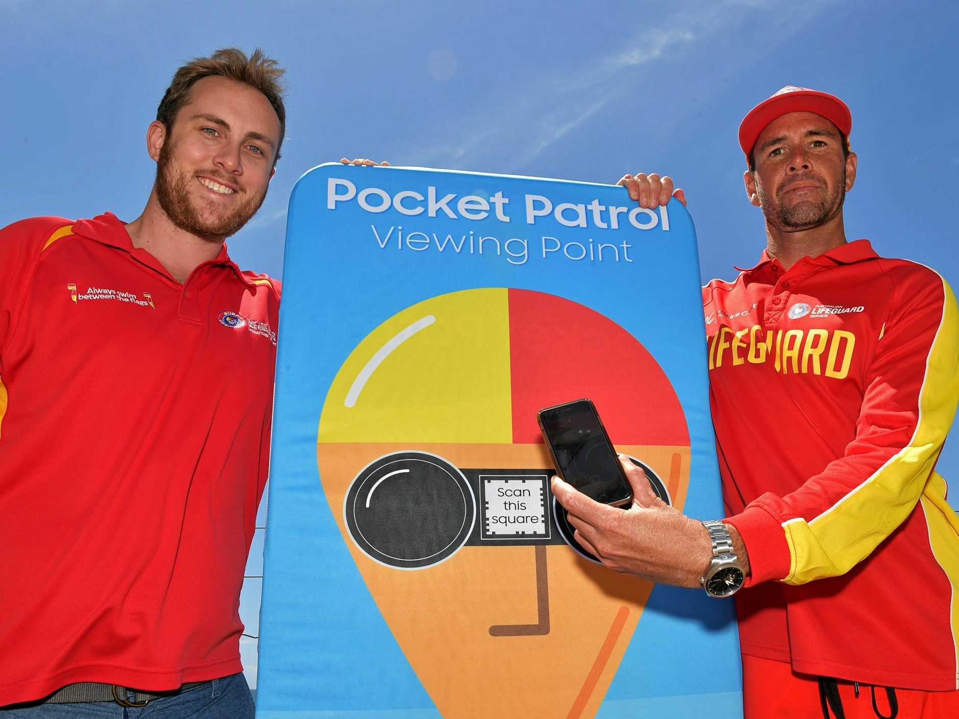 EXCITED: Aaron Purchase, Surf Life Saving Australia Sunshine Coast regional manager (left) with life guard Rob Adsett at Alexandra Headland, are testing out the new safety awareness app.