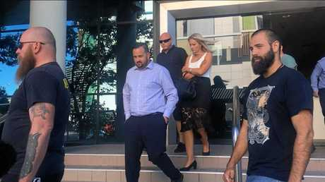 Security guard Shane Savy (centre) leaves Maroochydore Courthouse. He was assaulted by Robert Phillip Dunn, 25.