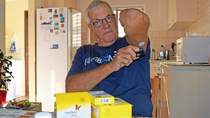 Alan Roker uses his FreeStyle Libre to check his blood sugar levels to manage his type 2 diabetes.