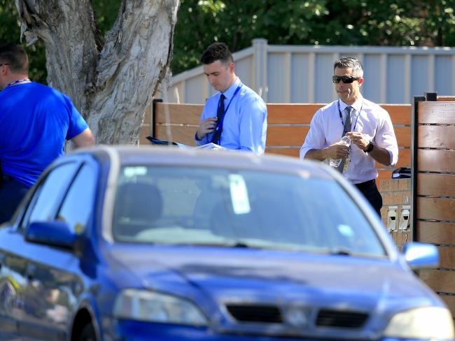 Detectives at the scene on Monday afternoon after a child was found in a car.
