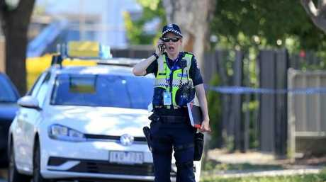 A police officer at the scene where a child has been found in a car
