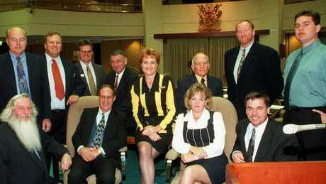 Pauline Hanson with One Nation MPs, (L-R) Ken Turner (kneeling), Jack Paff, Jeff Knuth, David Dalgleish, Charles (Charlie) Rappolt (seated), Harry Black, John Kingston, Dorothy Pratt (seated), Bill Feldman, Peter Prenzler (seated) and Shaun Nelson at Queensland State Parliament House in Brisbane in 1998.