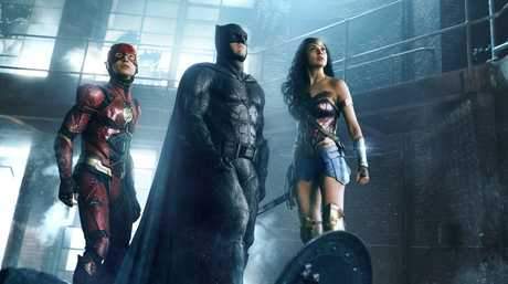Ezra Miller, Ben Affleck and Gal Gadot in a scene from the movie Justice League.