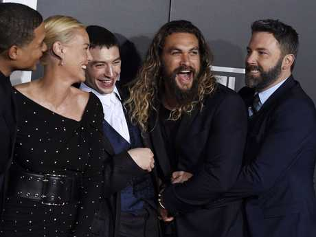 Ben Affleck, far right, a cast member in Justice League, greets fellow cast members, from left, Ray Fisher, Connie Nielsen, Ezra Miller and Jason Momoa at the premiere of the film at the Dolby Theatre in Los Angeles.