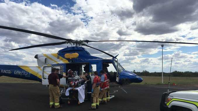 The man is loaded into the LifeFlight helicopter to be airlifted to Toowoomba Hospital.