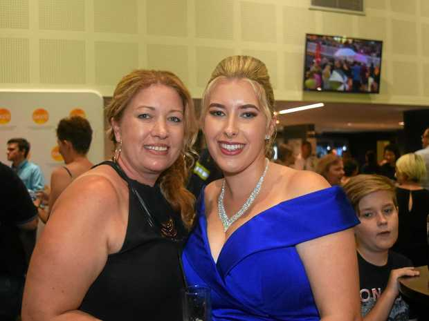 OVERWHELMING: Melissa and Kaitlin Miles mingled with hundreds of guests and their families in the foyer of the GECC.