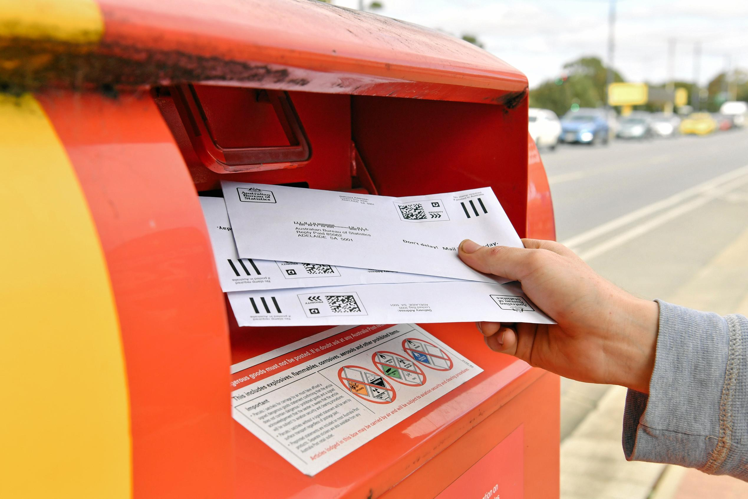 Sealed envelopes from the Marriage Law postal survey being posted.