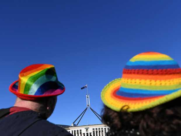Marriage equality advocates are seen during the 'Sea of Hearts' event supporting Marriage Equality outside Parliament House in Canberra.