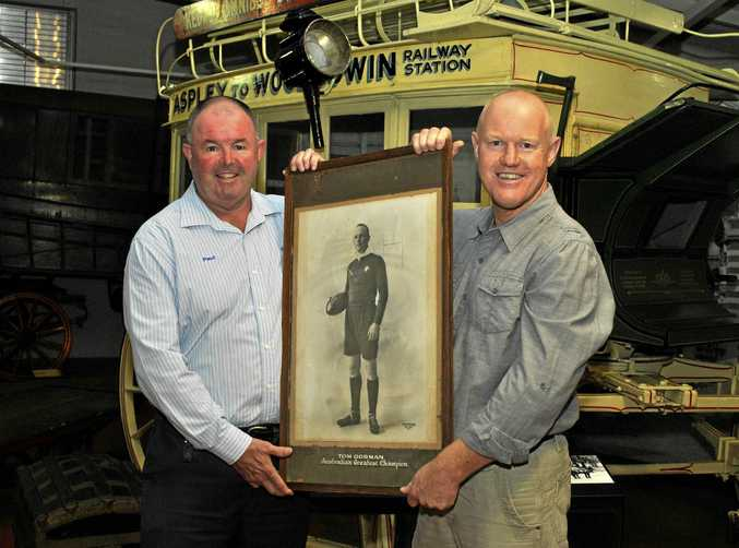 Paul Reedy (left) and Toowoomba Regional Sports Hall of Fame chairman Tony Coonan with a photograph of rugby league great Tom Gorman.