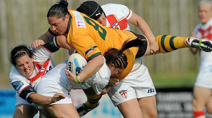 ANOTHER CUP: Stephanie Hancock is tackled by England in a World Cup game. Photo rlfwoc