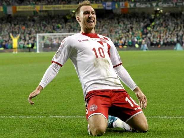 Christian Eriksen celebrates on of his three goals against Ireland.