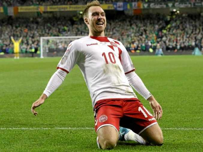 Christian Eriksen celebrates on of his three goals against Ireland.